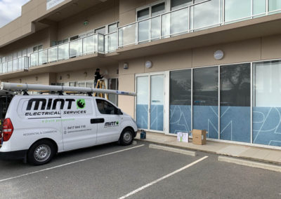Installation of front oyster lights upgraded to Atom 14watt LED commercial wall lights National Pharmacies Grange Road